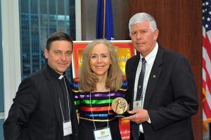 "Father Jonathan Morris, Carol Graham & Major General Mark Graham, accepting Yochi Dreazen's award for the winning book ""The Invisible Front."" The Grahams and their sons were the subject of the winning book."